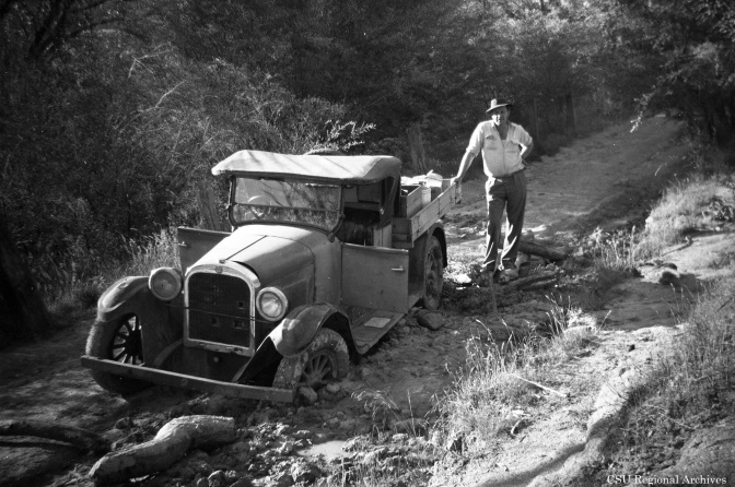An old ute bogged in the mud in the Snowy Mountains.